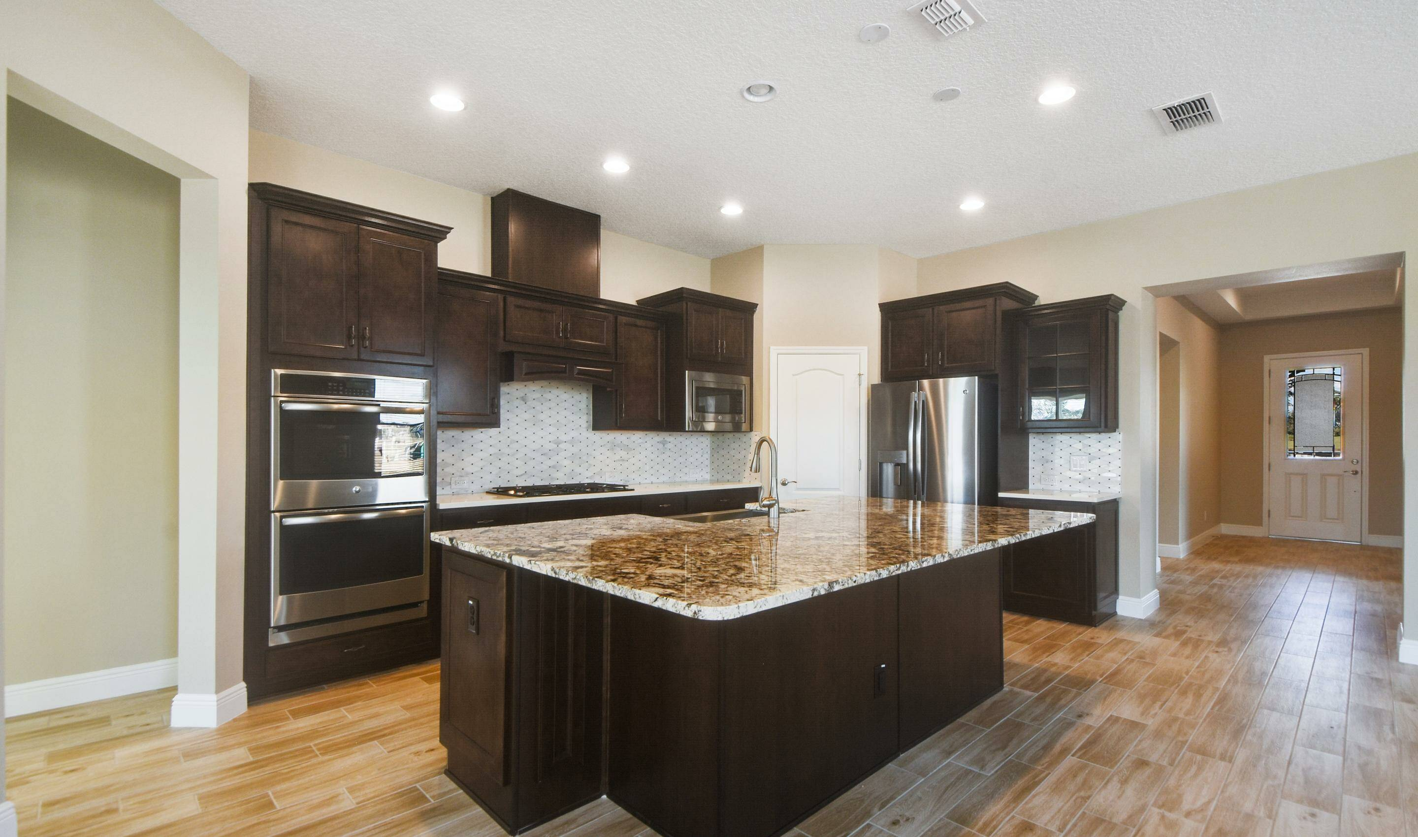 gourmet kitchen in the Barbados in Four Seasons at Orlando new homes in Orlando Florida