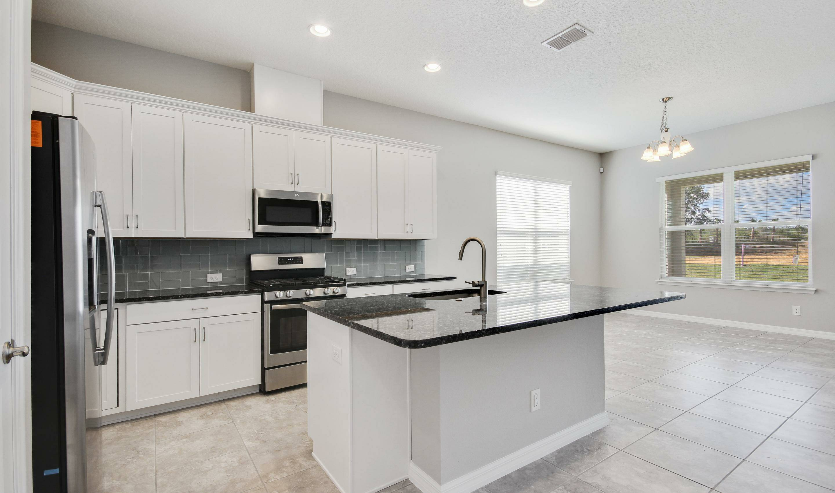 open concept kitchen in the Bermuda in Four Seasons at Orlando new homes in Orlando Florida
