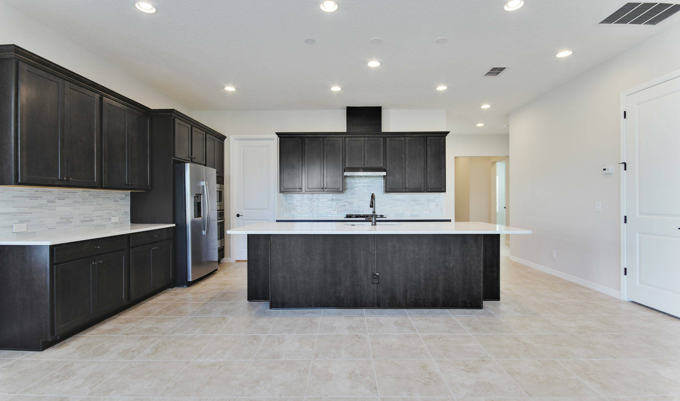 island kitchen in dunmore in four seasons at orlando new homes in orlando florida